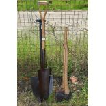 A quantity of vintage tools including felling axe, sledge, holing and American spades.