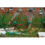 A painted pair of cast iron wagon Wheels, 43'' diameter.