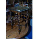A small oak occasional table.