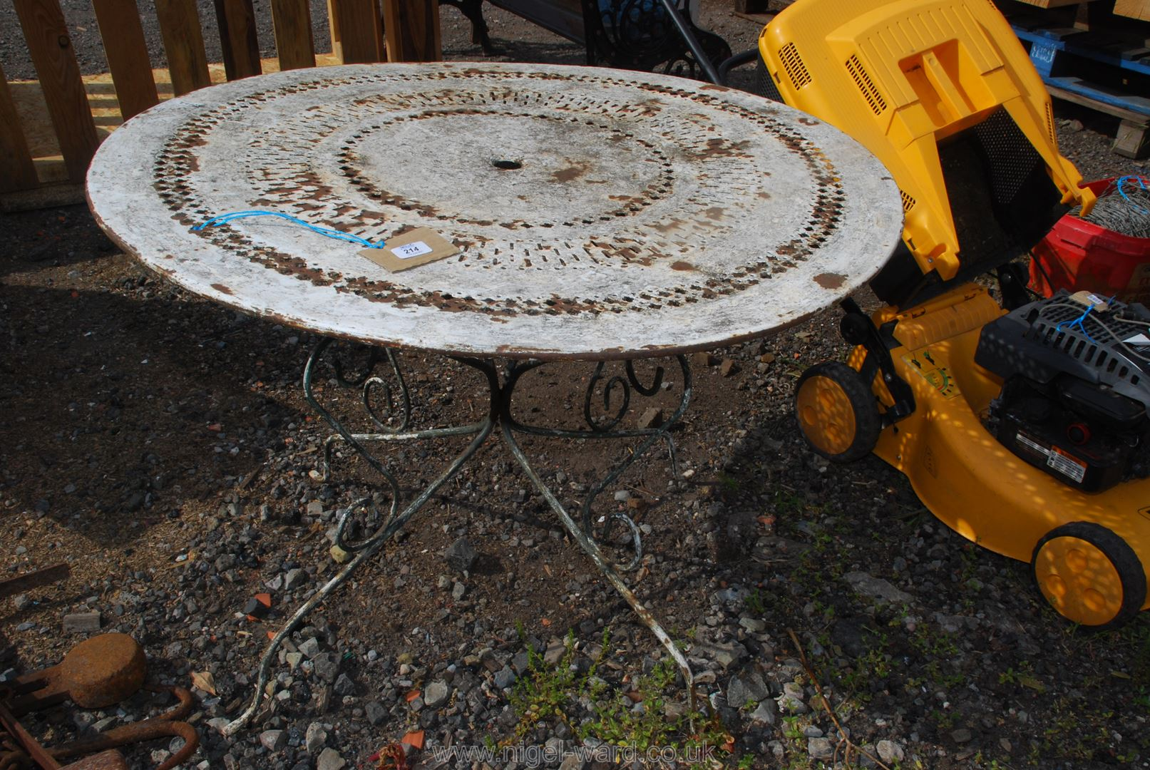 A lightweight 38'' diameter metal Patio Table.
