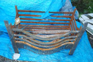 A cast fire basket, 26'' long x 13 1/2'' wide,