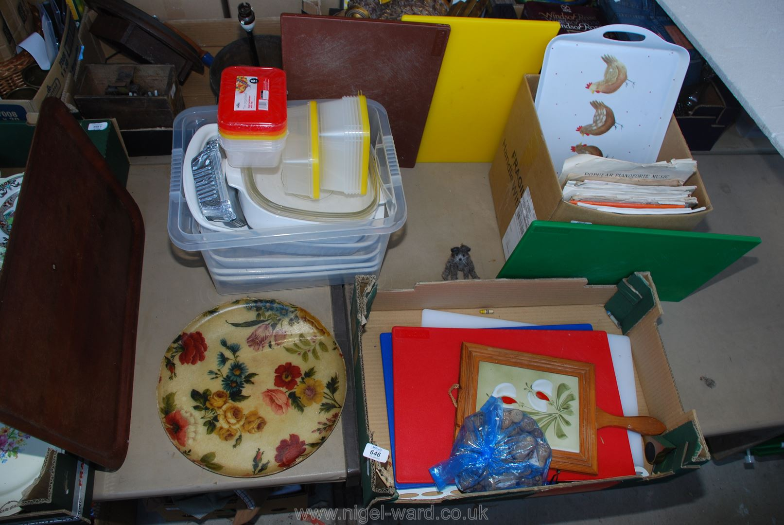 A quantity of coloured chopping boards, trays, white large cooking dishes etc.
