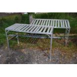 Two metal framed greenhouse benches.