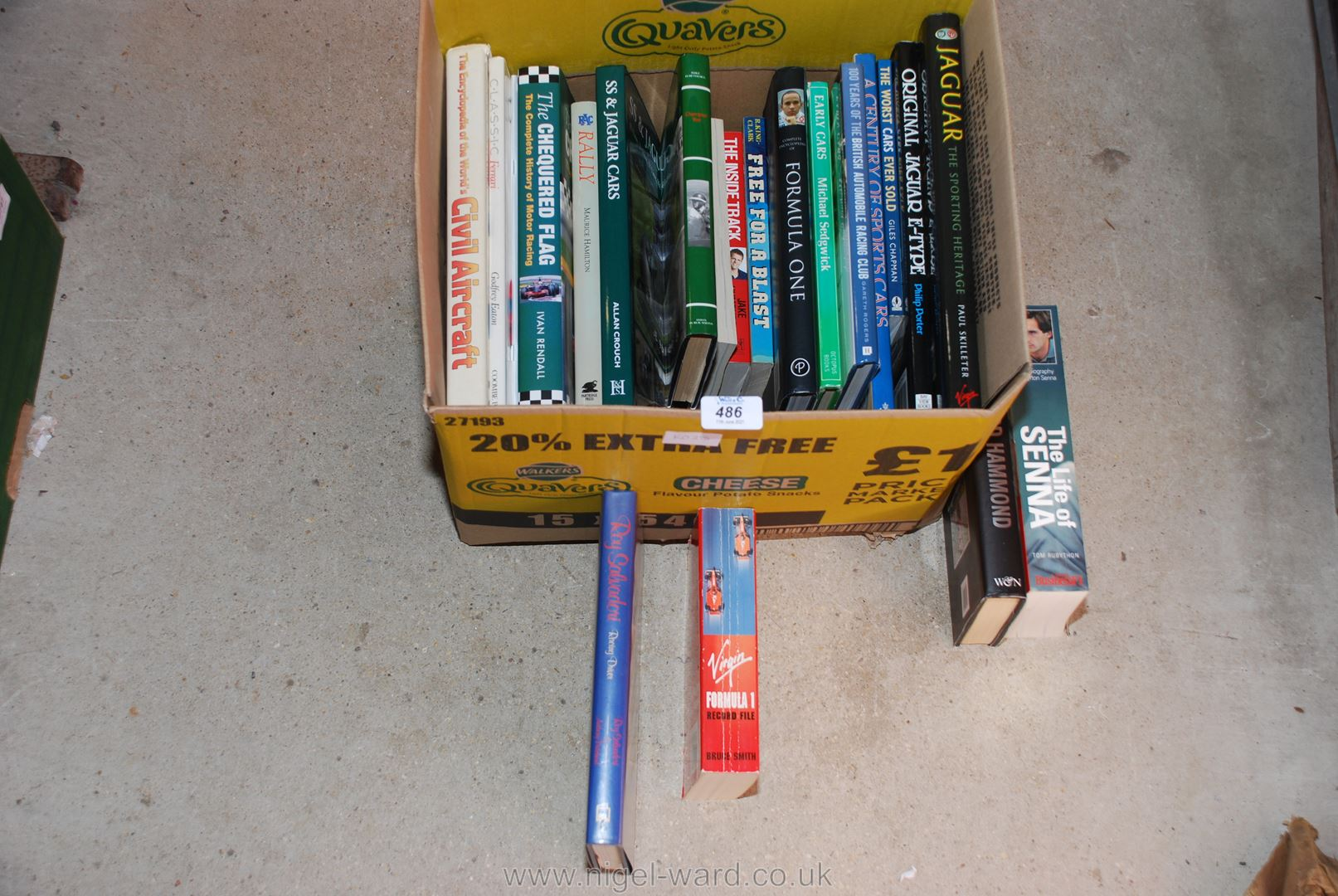 A box of motoring interest books and Formula 1 'The life of Senna'.
