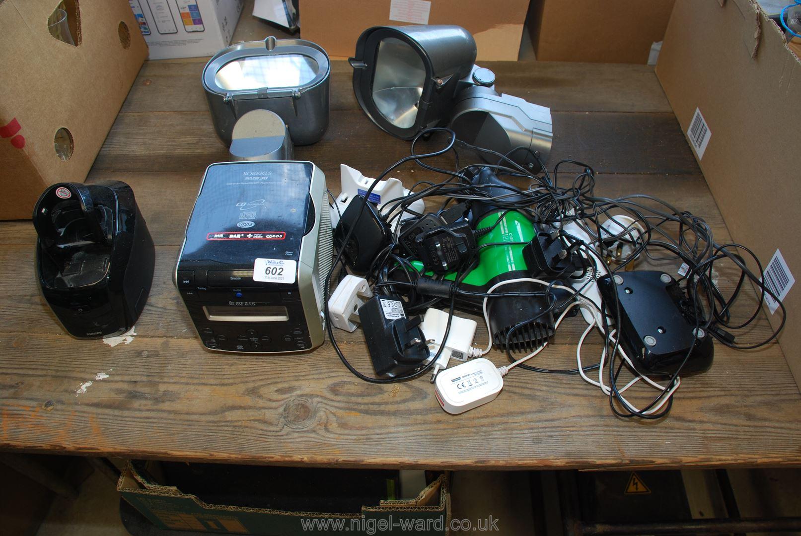 A box of two halogen lights, Roberts radio, cordless phones etc.