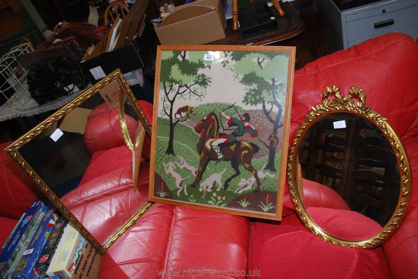 A Woolwork picture of a hunting scene and two mirrors.