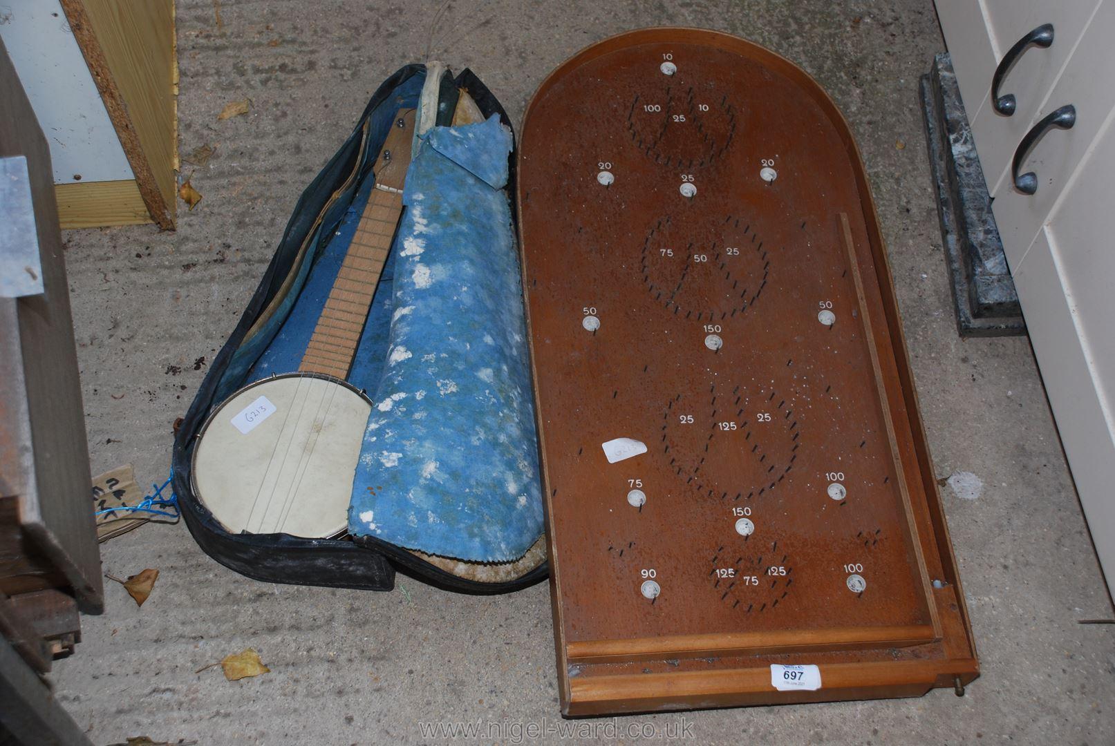 A Bagatelle board and a small banjo.