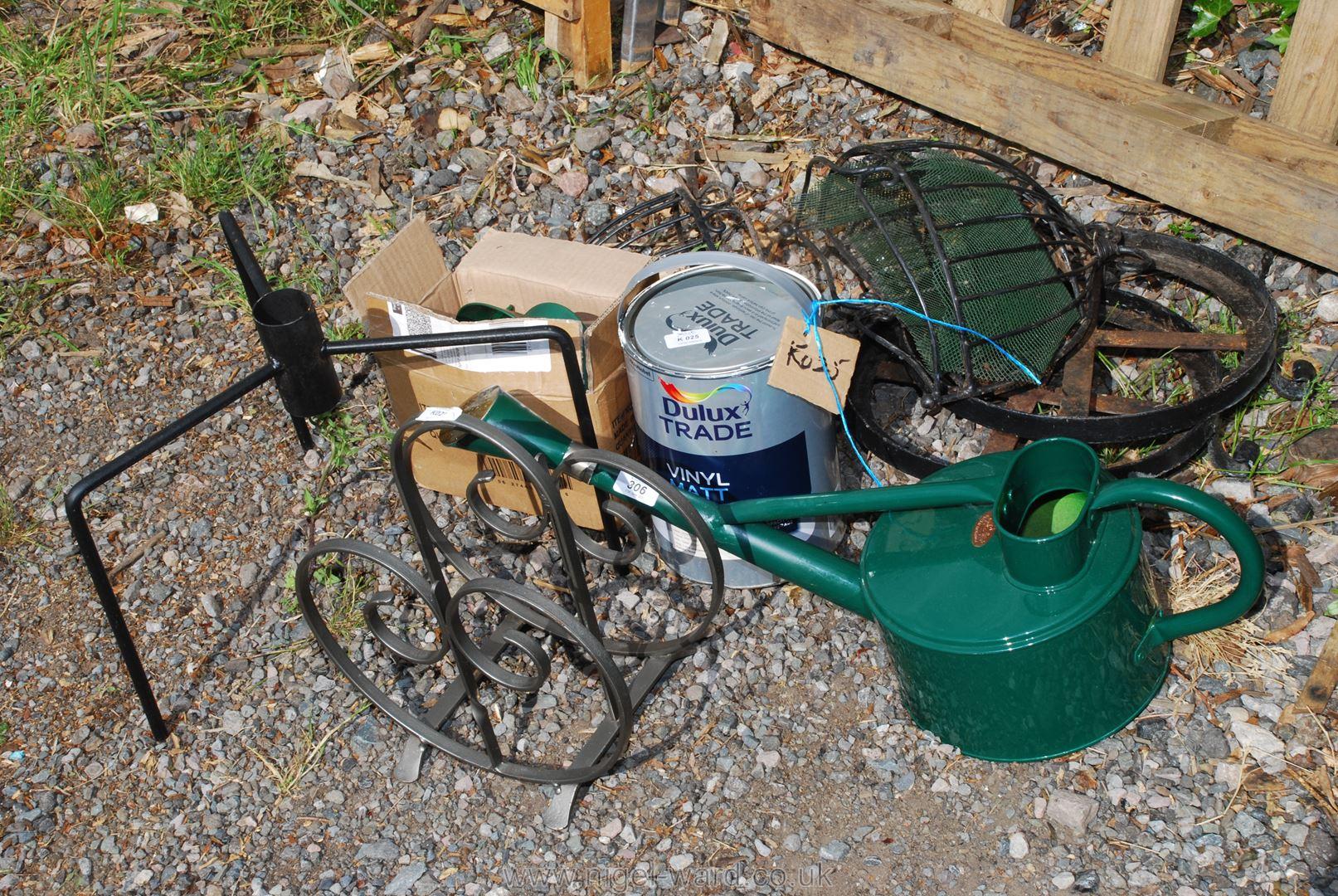 A metal watering can, Christmas tree stand, squirrel proof bird feeders, metalware, etc.