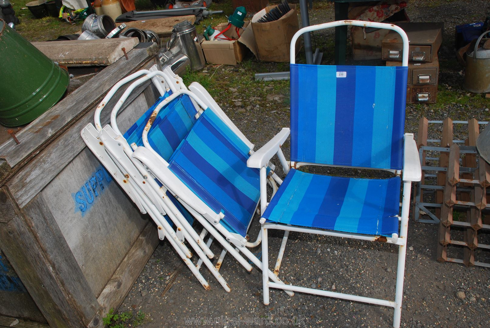Four folding picnic chairs.