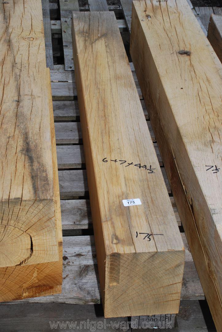 A piece of Oak, 6'' x 7'' x 49 1/2'' long.