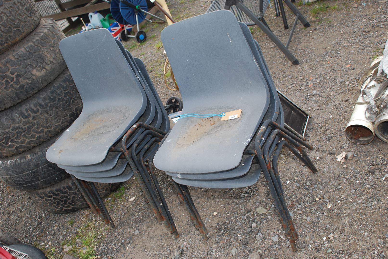 Seven school style stacking Chairs.