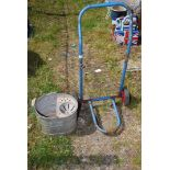 A galvanised mop bucket and a trolley sack truck.