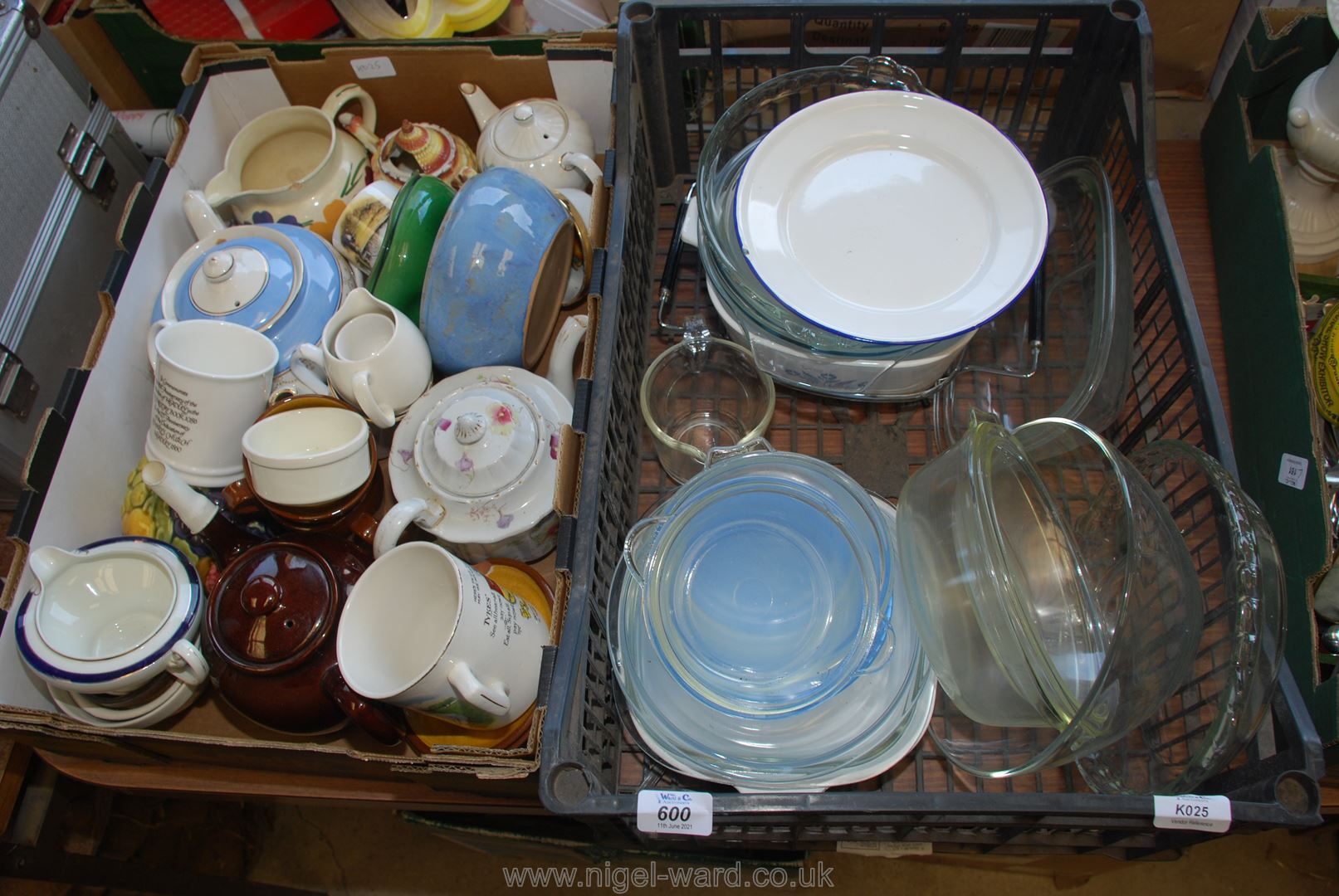 A box of various teapots, mugs and a crate of kitchen glassware.