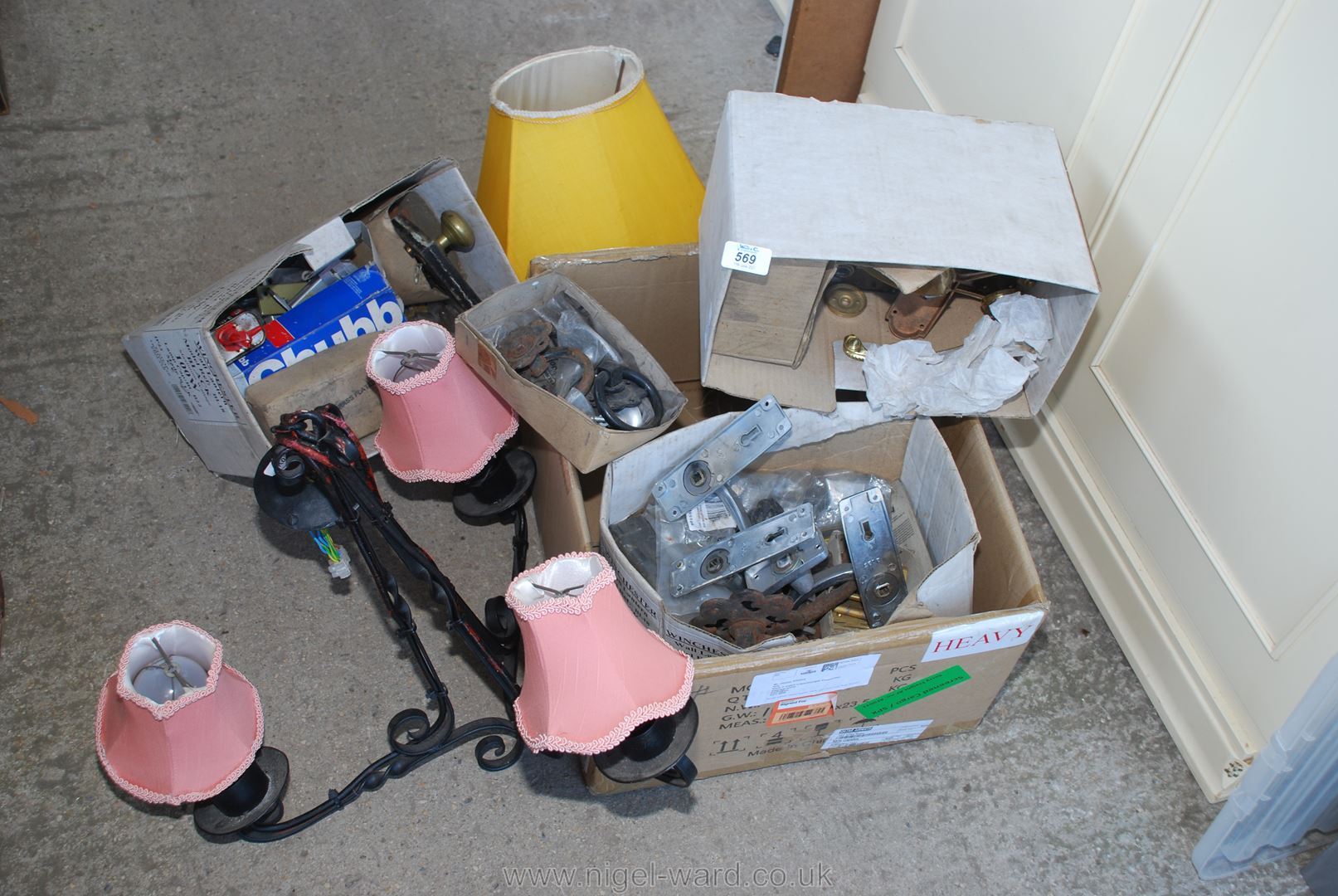 A box of door ironmongery and a wrought iron ceiling light.
