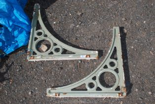 A pair of cast iron brackets,