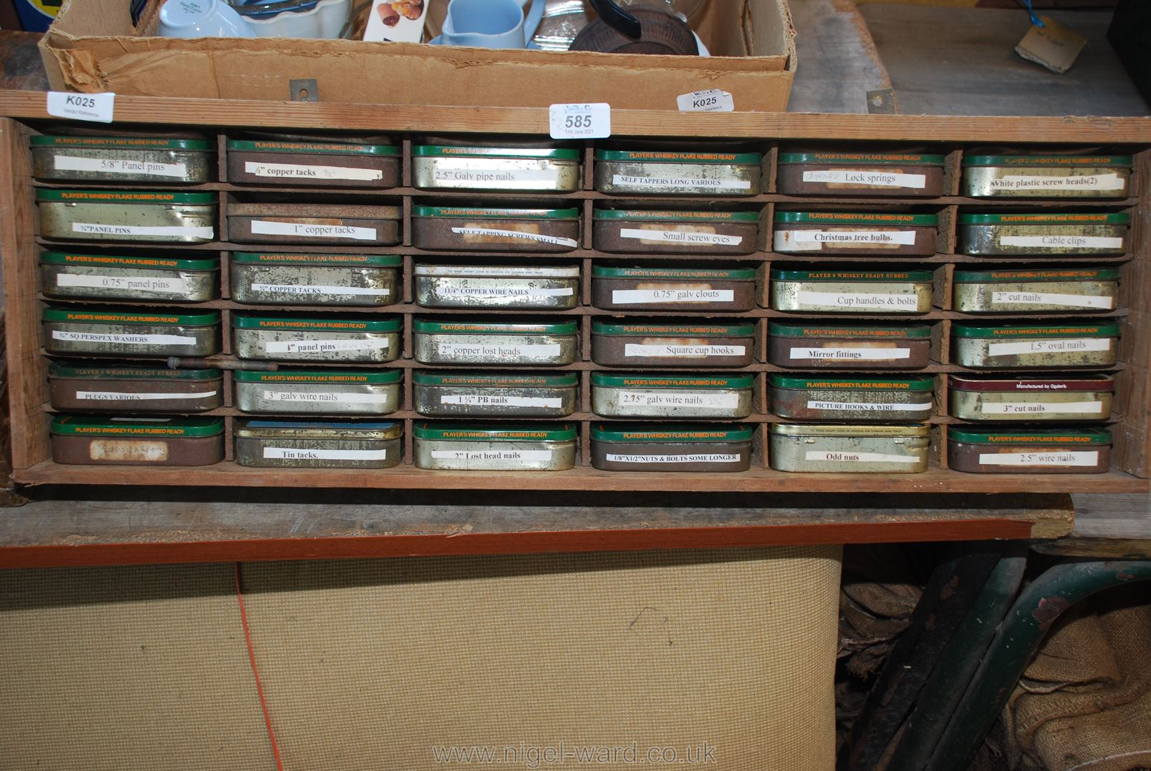 A shelf unit containing 30 tins of various screws and fixings.