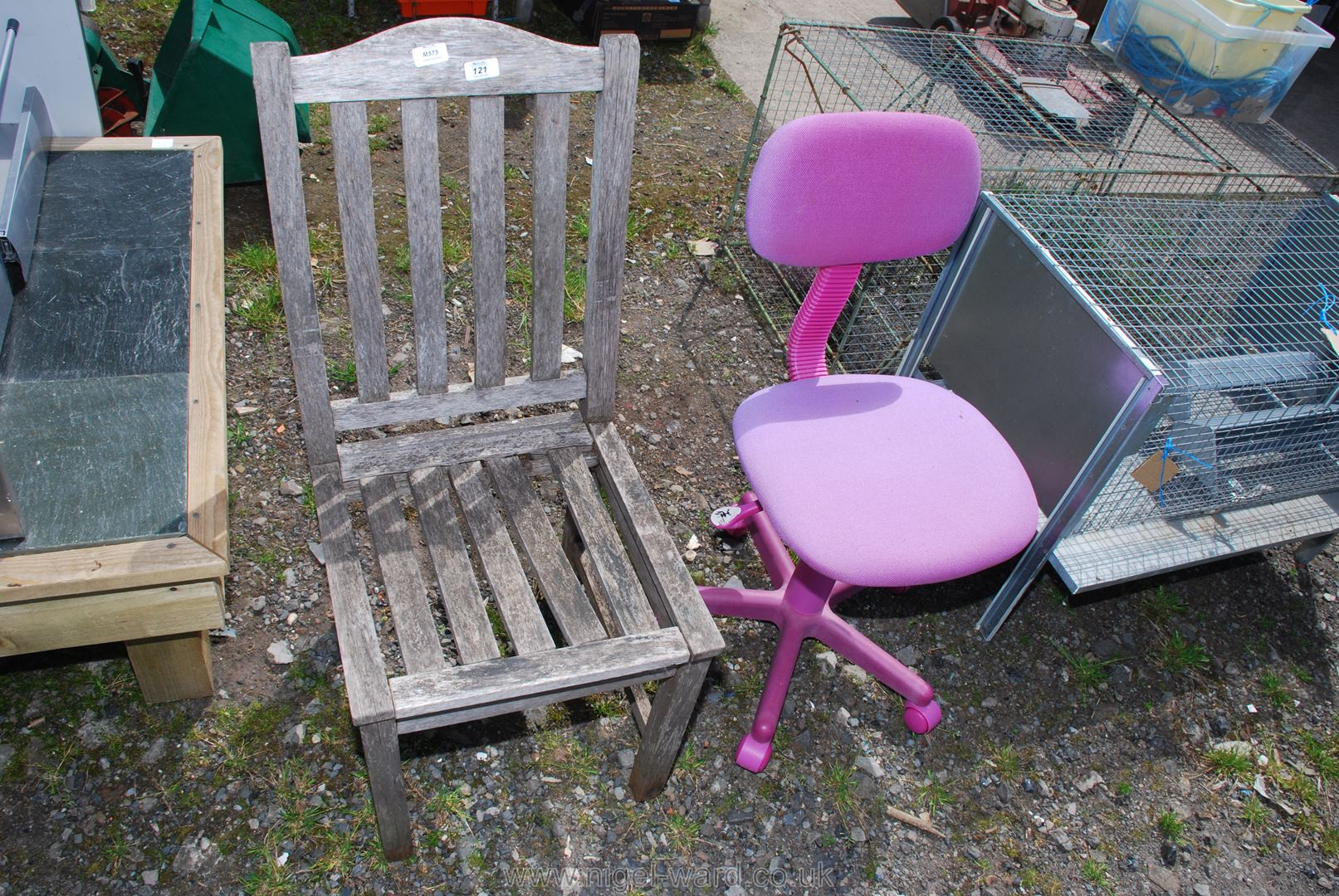 A wooden Patio chair and a child's computer chair.