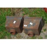 Two cast metal rainwater hoppers.