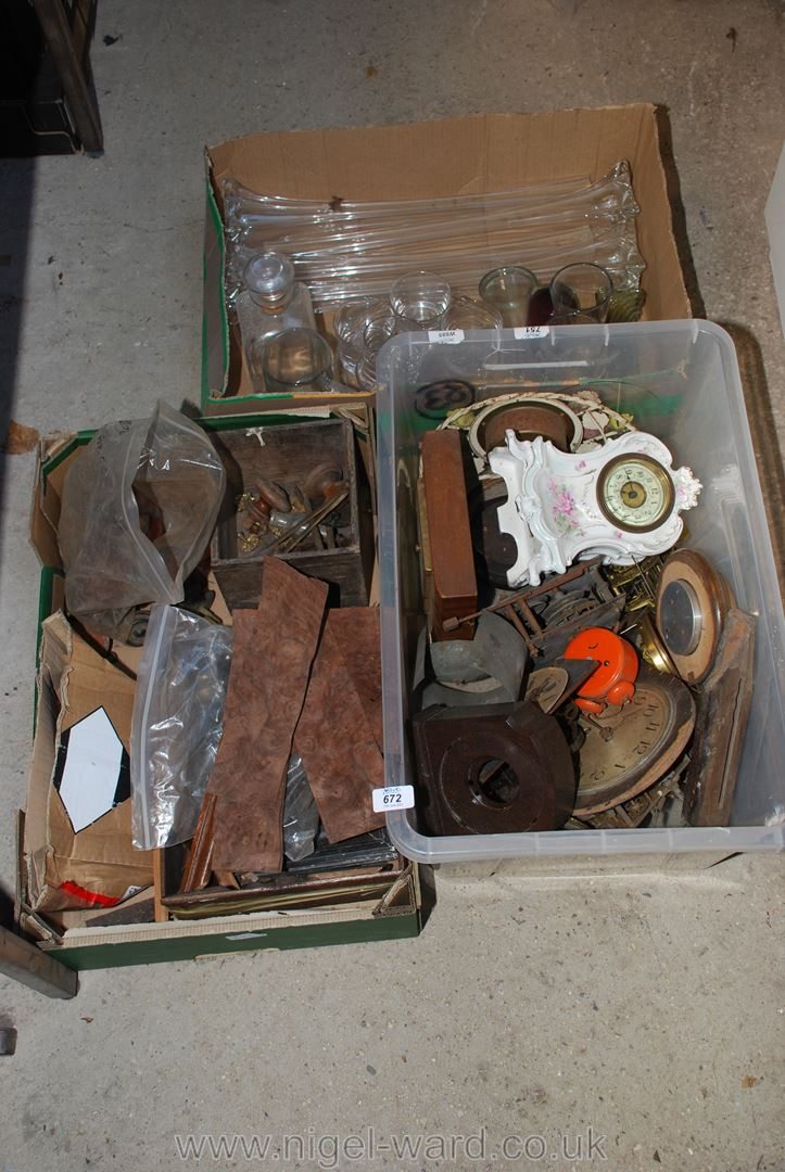 A quantity of clock parts, bobbin furniture knobs and a box of glass vases etc.