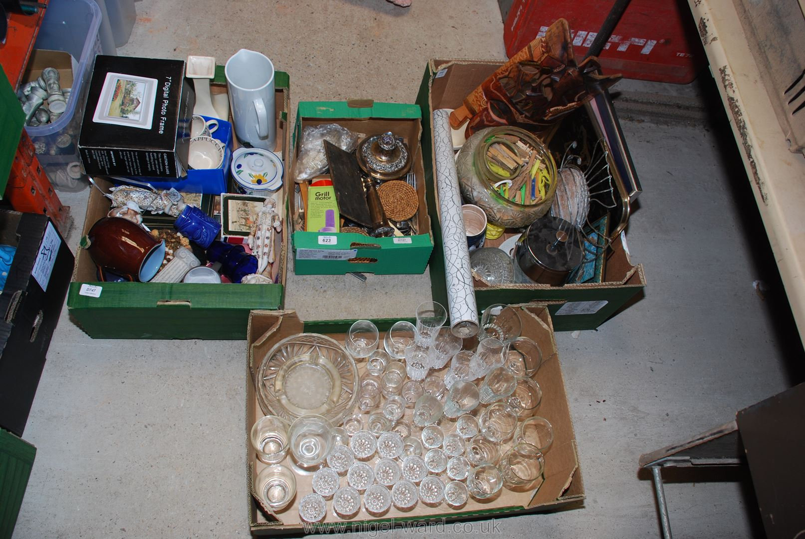 Four boxes of various drinking glasses, cutlery, china, glassware and a digi photo frame.