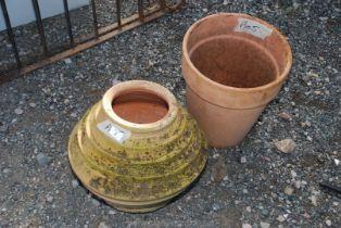 A terracotta Pot and a honey pot shaped Planter.
