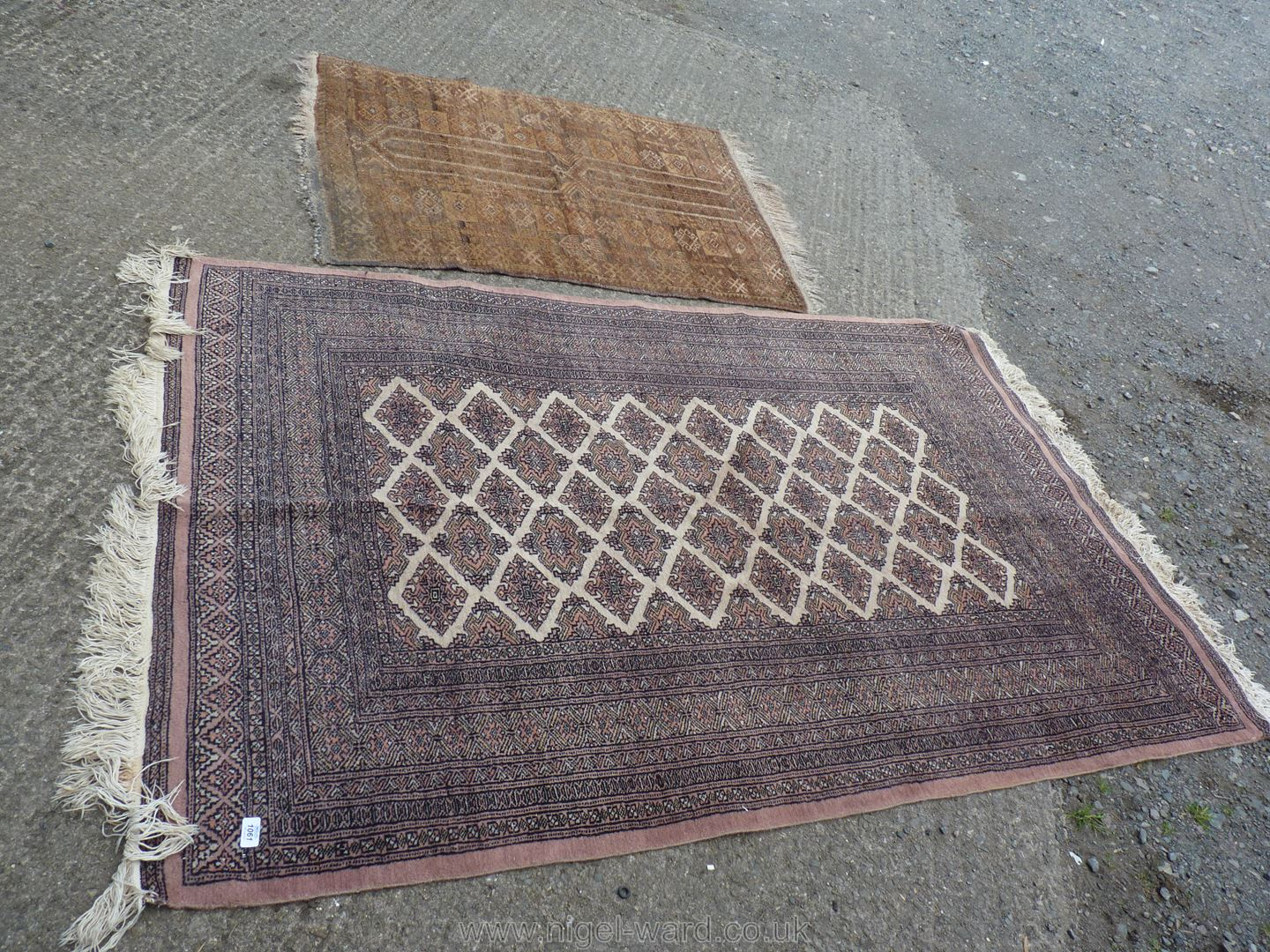 """A brown and cream rug with fringing, 78"""" x 50"""", and another rug, 39"""" x 35""""."""