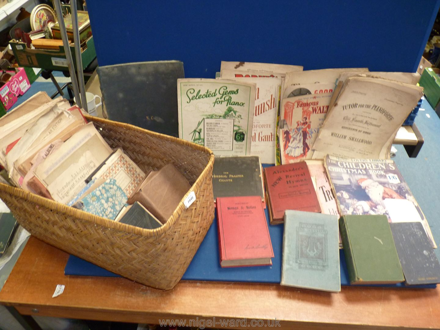 A Filing basket of vintage book and sheet music.