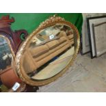 An oval bevel plate wall Mirror with pretty gilt frame, 28'' x 19''.