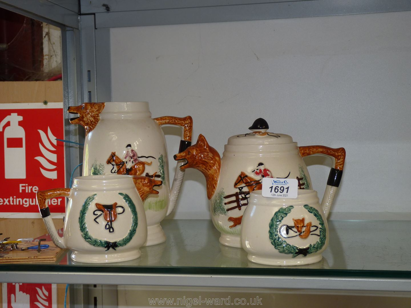 A four piece Hunting Teaset comprising teapot, large and small Jug and sugar bowl,