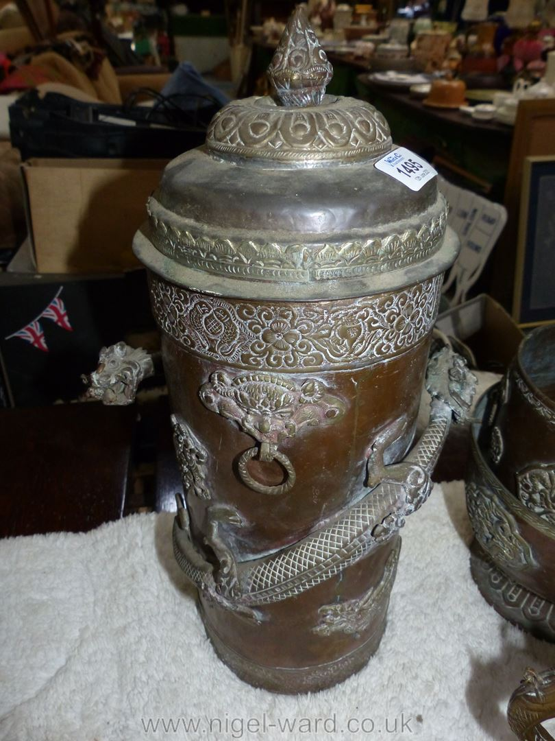 A large Tibetan brass and copper ceremonial canister with brass dragon wrapped around the outside