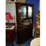 A heavy dark Oak Corner unit having a base with opposing raised and fielded panelled doors,