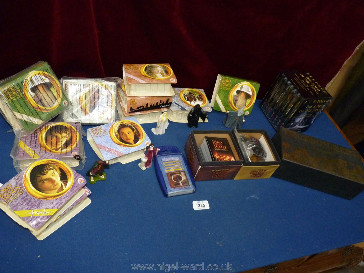 A box of figures and trading cards from Lord of The Rings together with two audio cassettes of The