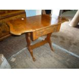 A Mahogany and Walnut dropleaf Occasional Table standing on splay feet with narrow shelf/stretcher,
