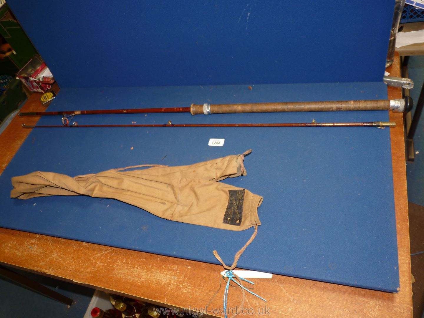 An Alex Martin glass fibre two piece Spinning rod marked 'Salmon 7 lbs',