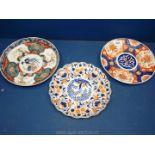 Three Imari plates: Chinese 18th c. enhanced with gilding, Japanese 19th c.