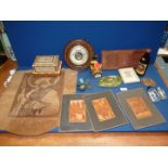 A box of miscellanea including four straw/reeded pictures, book slide, round barometer,
