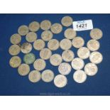 A quantity of George VI and Queen Elizabeth II shillings 33/- worth in total.