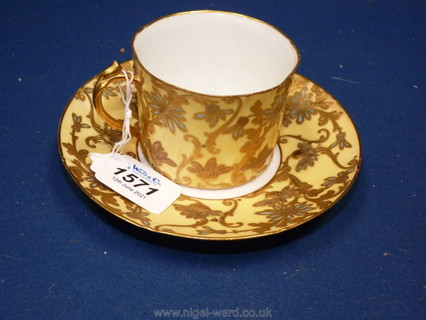 A Sevres Louis Philippe cup and saucer decorated with flowers in raised gold impasto highlighted in