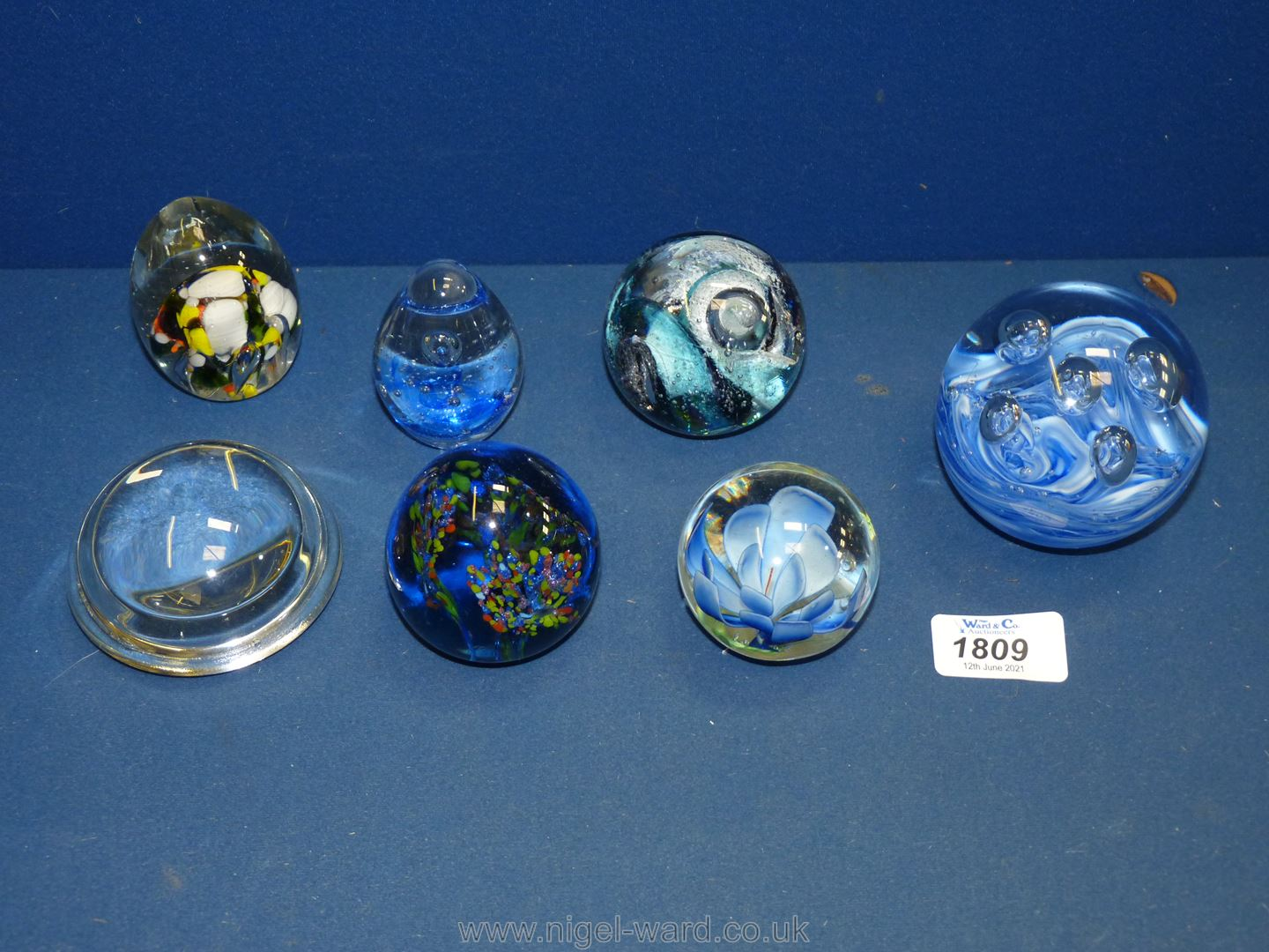 Seven paperweights including millefleur type, abstract, blue swirl etc.