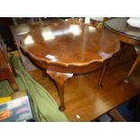 A pie crust edged 1/4 veneered Walnut top occasional Table standing on four cabriole legs,
