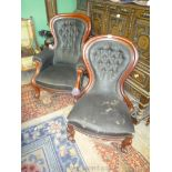 A pair of Mahogany show frame buttoned back Armchairs, lady's and gentleman's,