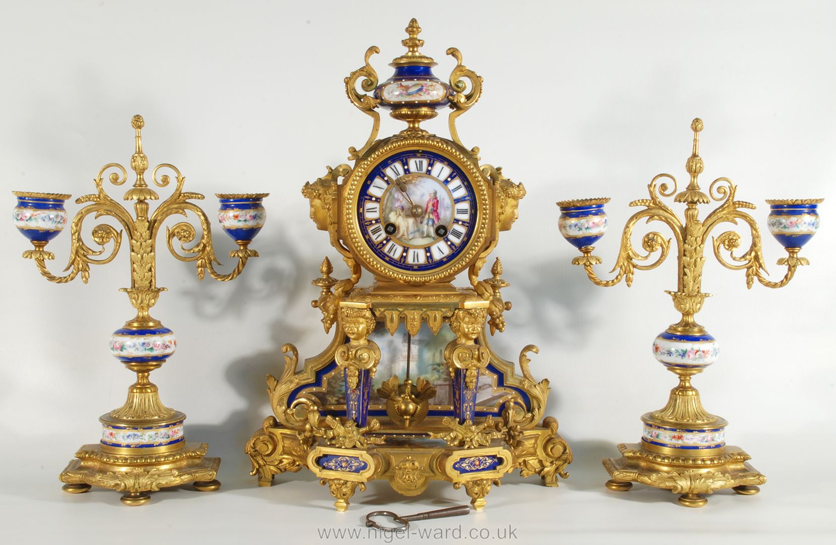 An exceptionally attractive French Ormolu and porcelain mantle Clock the two-train movement by
