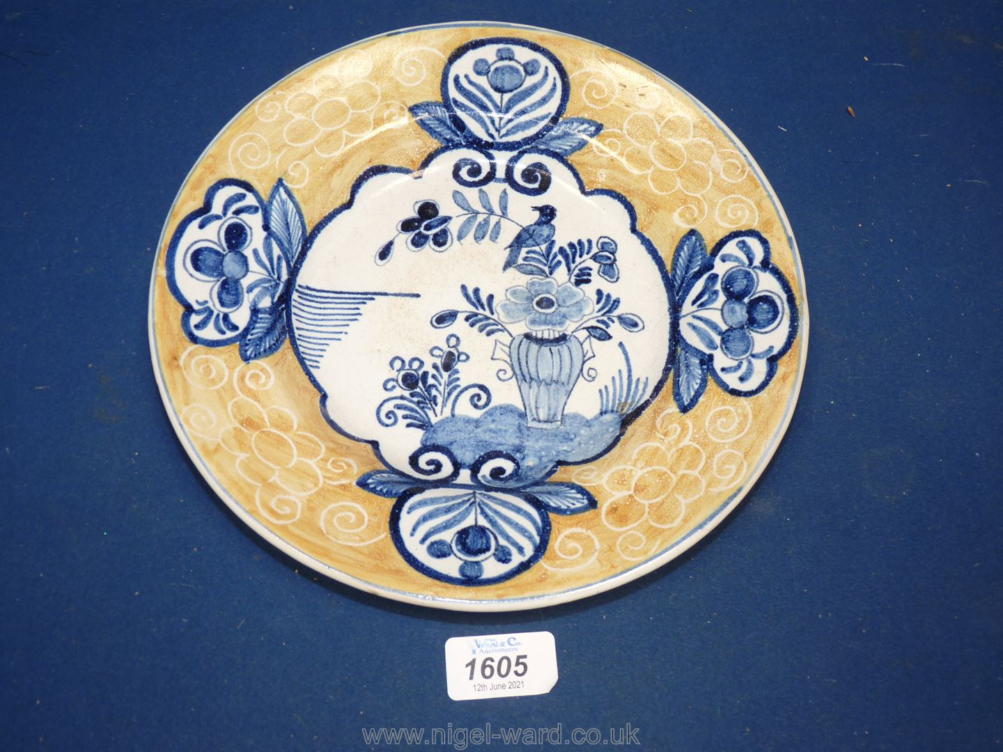 An early Dutch Delft plate painted in the Chinese style in blue within a cafe au lait rim,