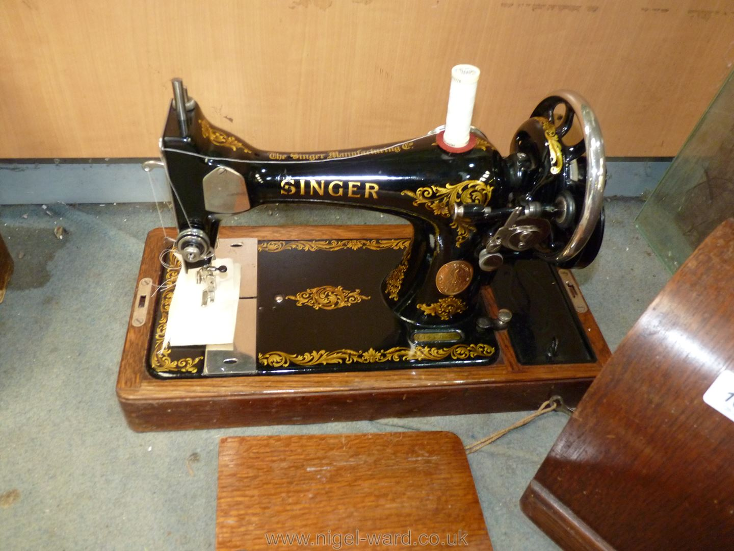 A Singer sewing machine in wooden case with key