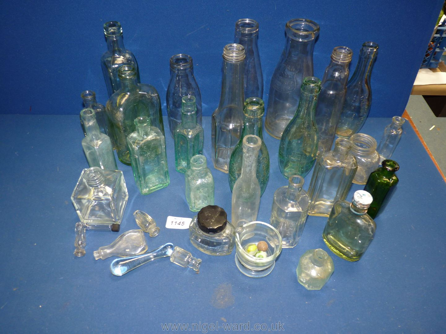 A quantity of old bottles including milk, Camp Coffee, Arliss Robinson, cough mixture, etc.