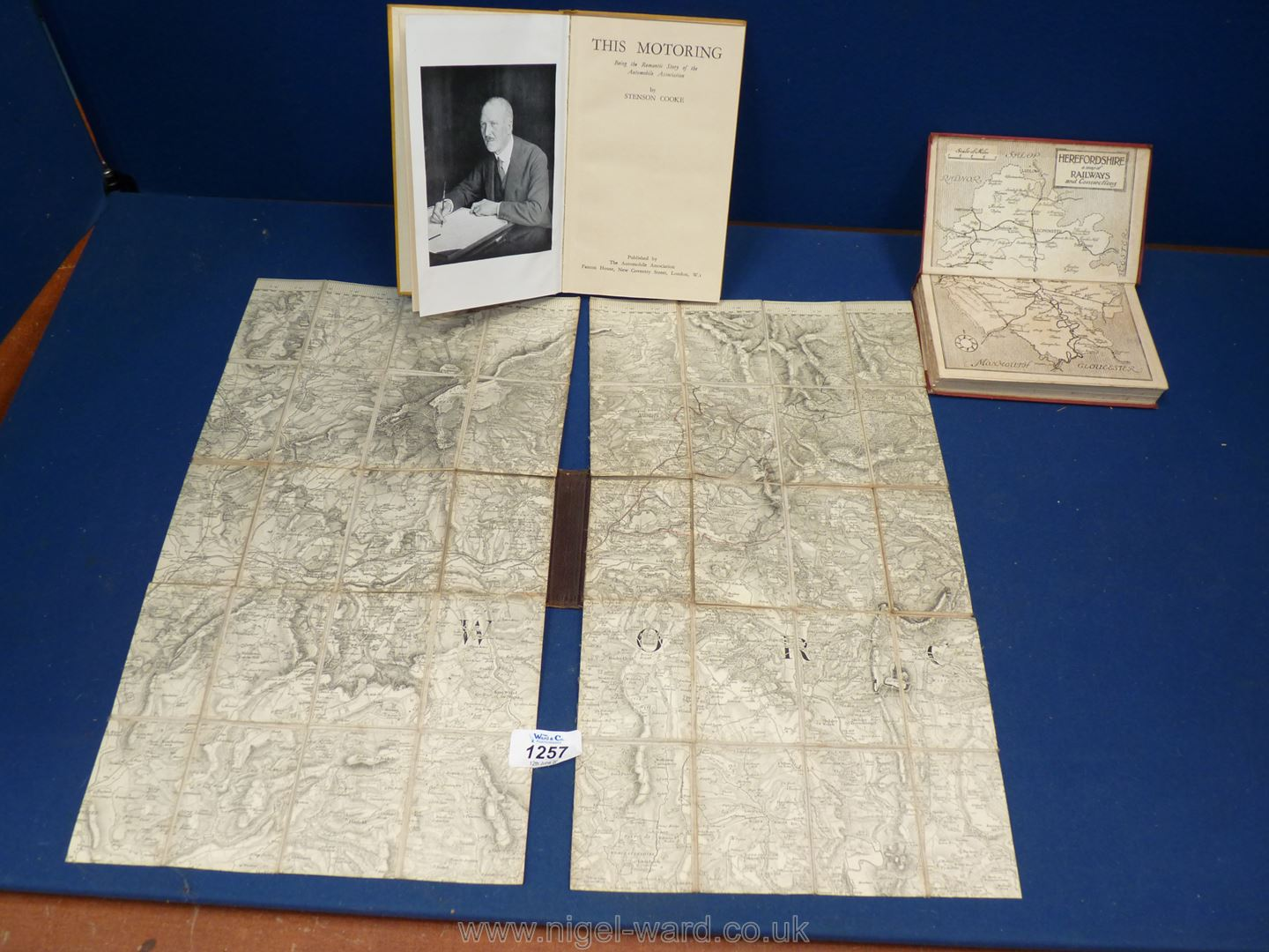 A leather clad and gold initialled folding map of Herefordshire,