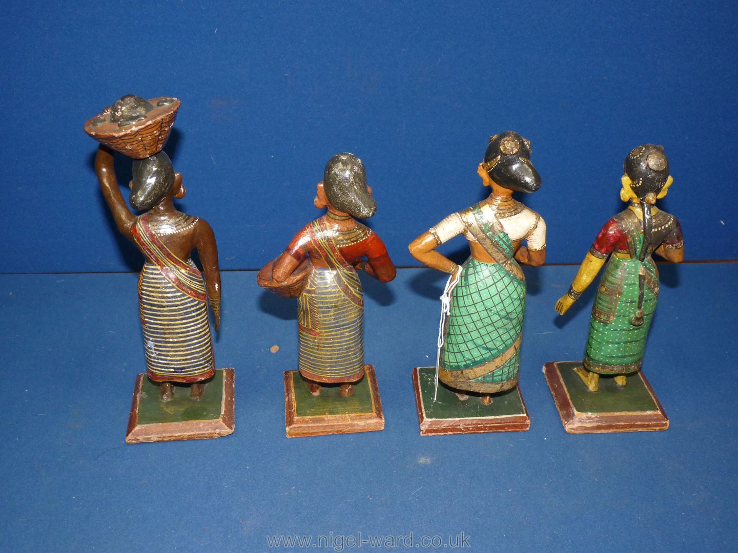 A set of four Indian carved and painted wood figures of lady market traders, circa 1900, - Image 2 of 3