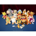 A box of soft toys including Winnie the Pooh, Tigger, Piglet and Eeyore.