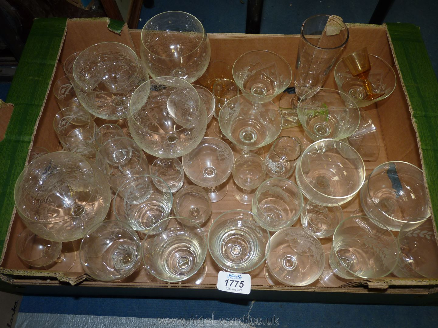 A quantity of glass including etched gin glasses, champagne glasses, wine goblets,