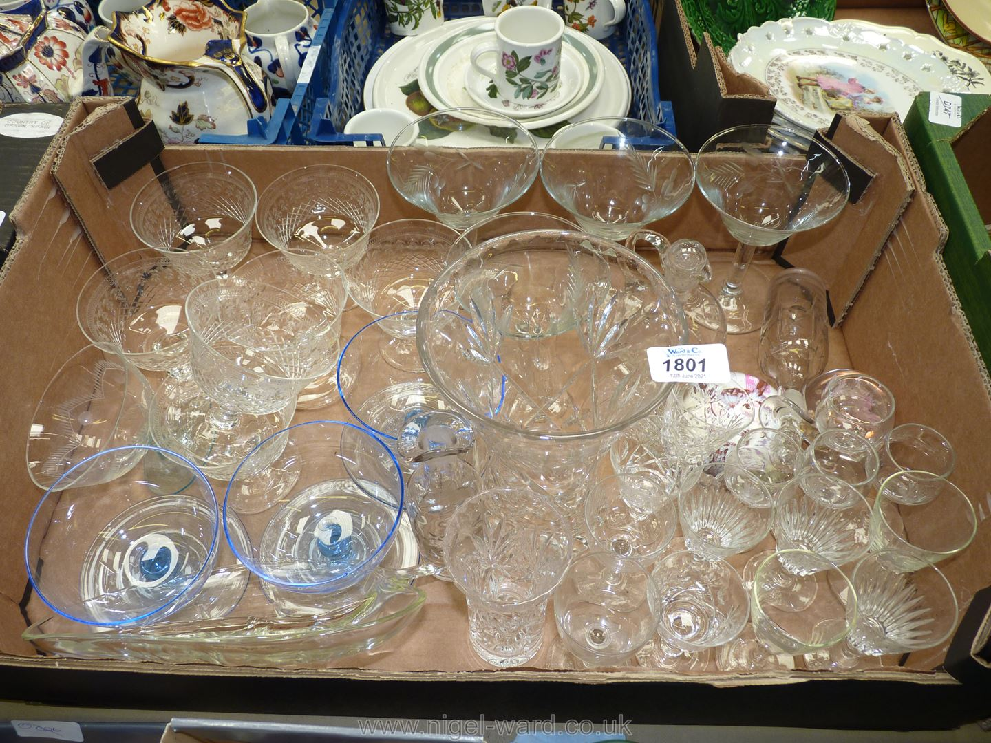 A quantity of glass including four engraved cocktail glasses, two scent bottles with stoppers,